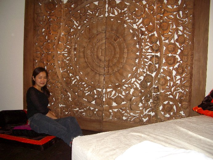 The magnificent wooden carved double-sliding door